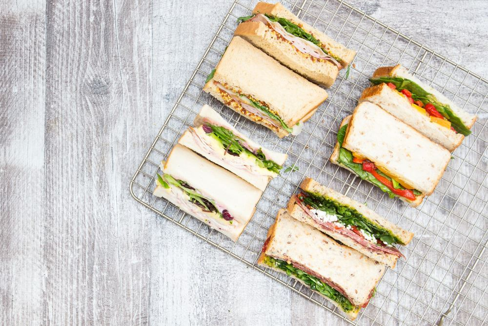 Individual rustic sandwiches cut in half
